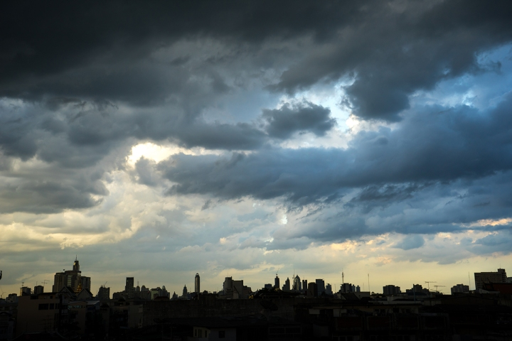 Dark blue storm clouds over city in rainy season