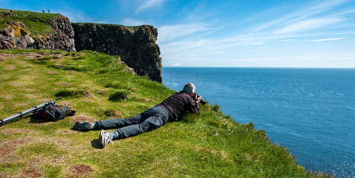 Photographer in Latrabjarg Cliffs, Westfjords, Iceland