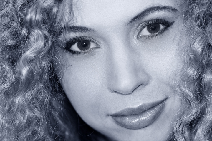 Portrait of a curly blond woman