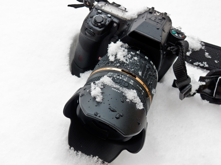 Camera And Lens In Snow