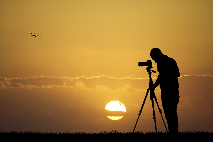 photographer at sunset