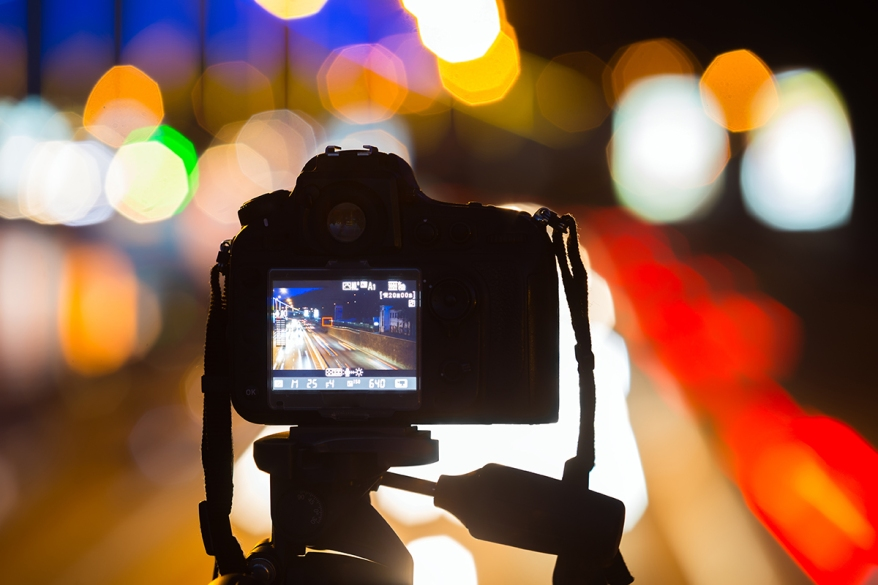 The camera shoots traffic on the night road