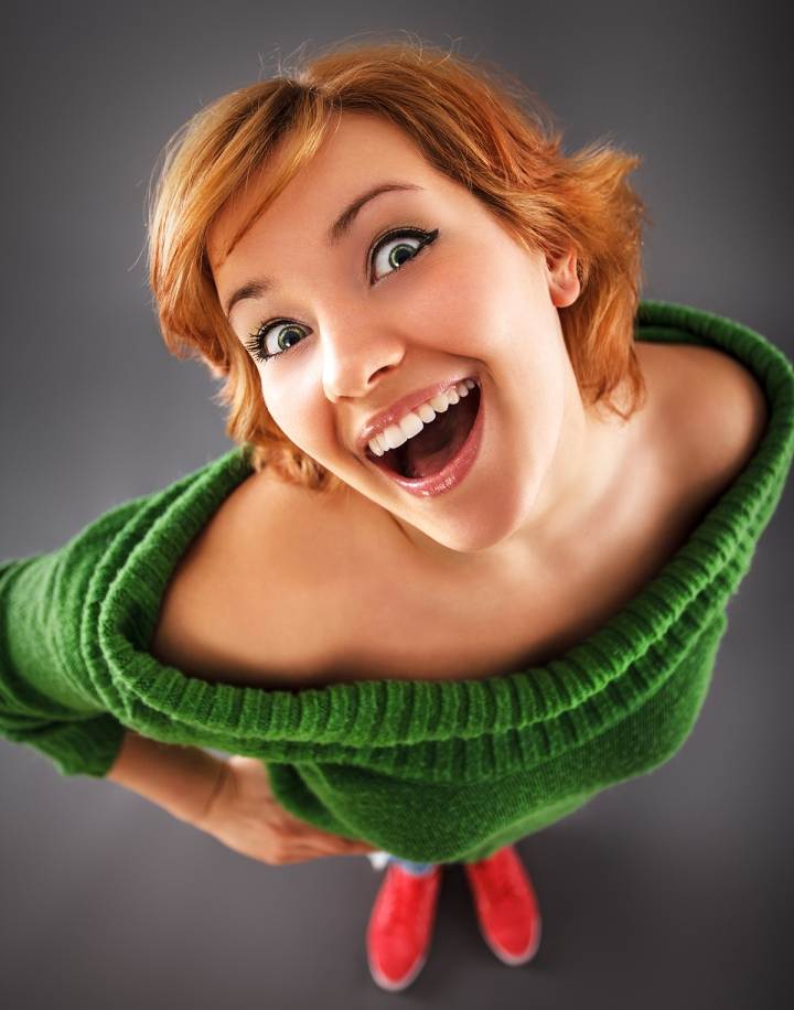 Young female teen with red hair making funny face.Wide angle sho
