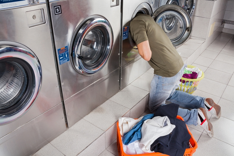 Man Searching Clothes Inside Washing Machine