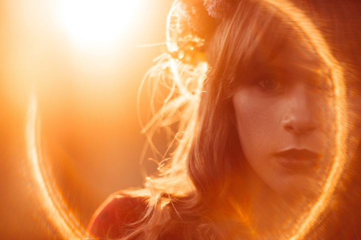 Portrait of beautiful woman, lens flare effect