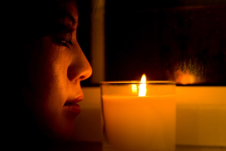 Chinese girl looking at a candle.