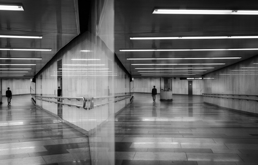 black and white art photography monochrome in noir style, a man walking the underground passage