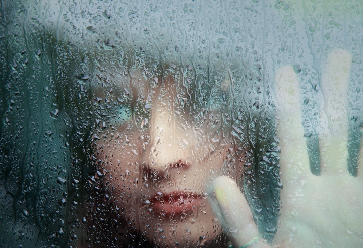Sad young woman and a rain drops