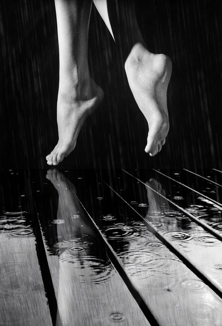 female legs on a wet wooden floor