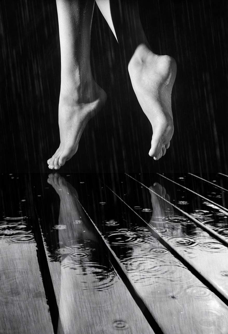 female legs on a wet wooden floor