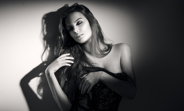 Sexy young woman black and white portrait. Seductive young woman