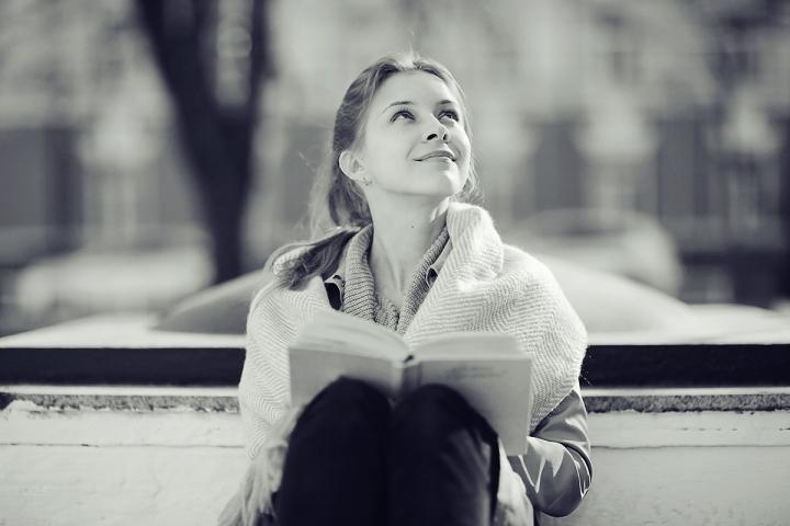 monochrome urban portrait of a woman in a coat