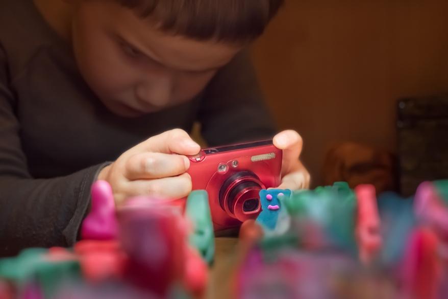 Young photographer taking photo. Animation school. Young photographer taking photo. Photography school