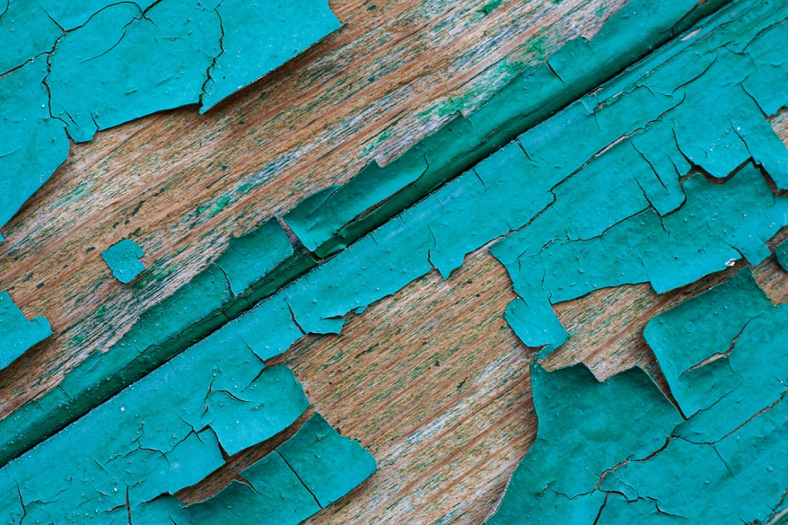 Texture of old wooden boards with peeling paint