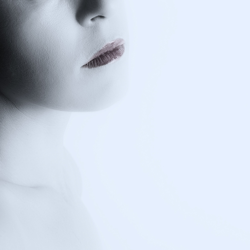 High key fine art portrait of woman mouth and chin on a bright white background