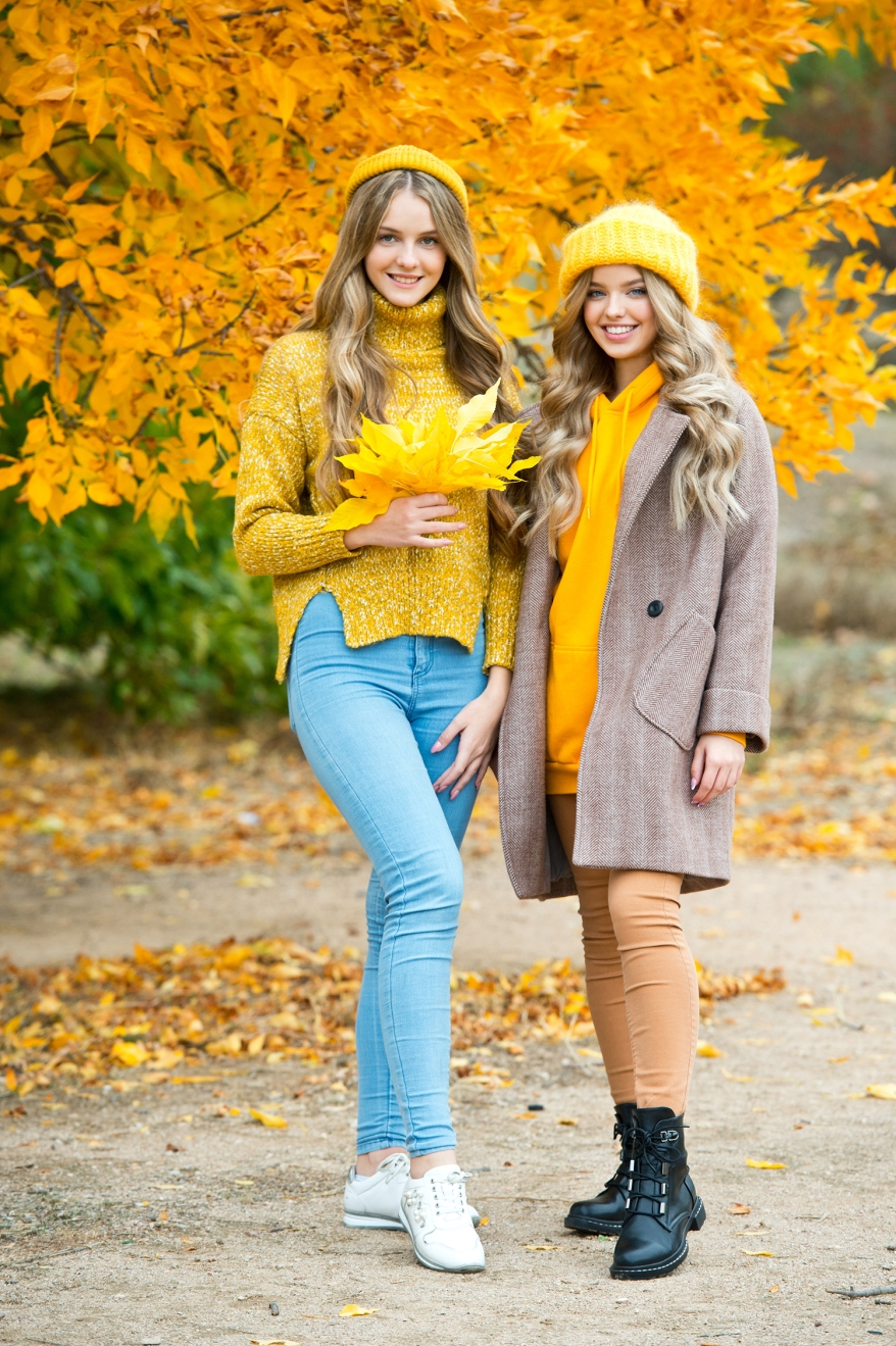 Friends enjoy an autumn day in the Park. Young happy women with