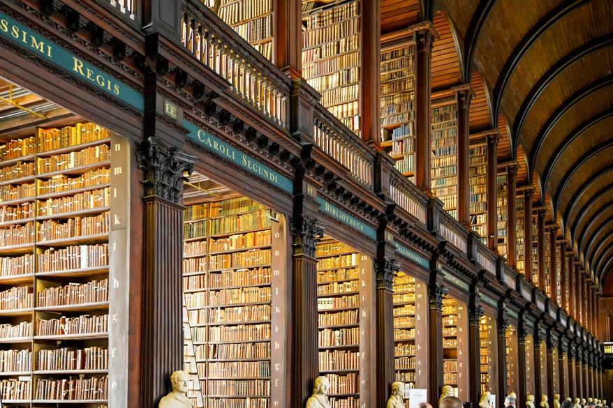 DUBLIN, IRELAND - JULY 1, 2019: The Library of Trinity College Dublin (Irish: Leabharlann Choláiste na Tríonóide) serves Trinity College and the University of Dublin. Book of Kells is in this library